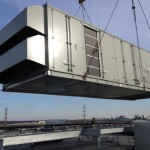 HVAC Equipment Being Lifted onto Building Roof