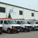Service Vans in a Row Outside of Geauga Mechanical Building